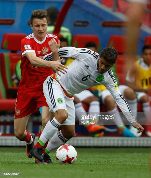 Aleksandr Golovin of Russia national team and Jonathan Dos Santos of Mexico national team during the Group A FIFA Confederations Cup Russia 2017...