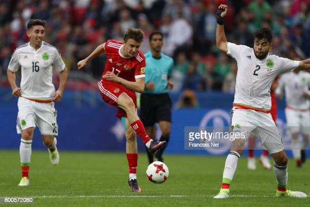 Aleksandr Golovin of Russia shoots during the FIFA Confederations Cup Russia 2017 Group A match between Mexico and Russia at Kazan Arena on June 24...