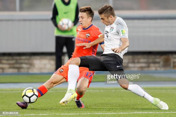 Aleksandr Karnitsky of FC Tosno and Aleksandr Golovin of PFC CSKA Moscow vie for the ball during the Russian Football League match between FC Tosno...