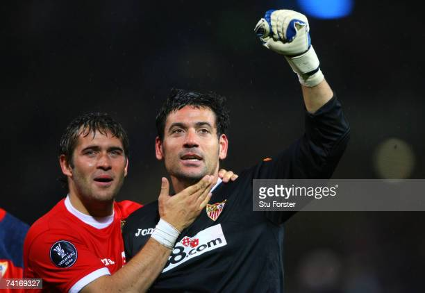 Aleksandr Kerzhakov celebrates with Andres Palop of Sevilla after their team's victory in a penalty shootout at the end of the UEFA Cup Final between...