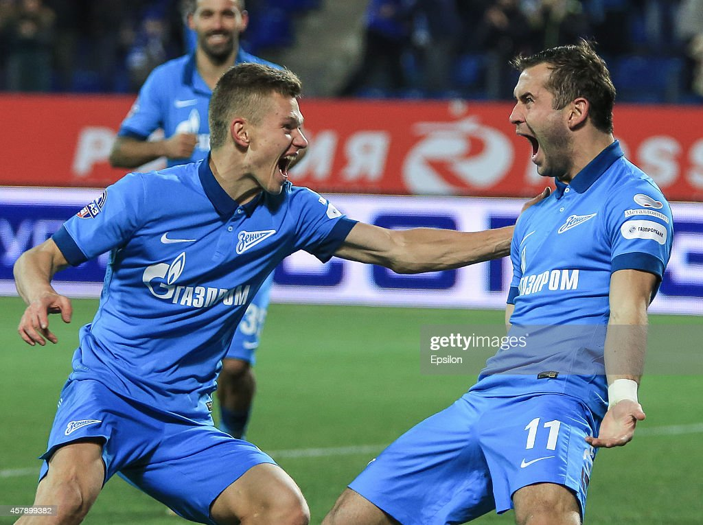 <a gi-track='captionPersonalityLinkClicked' href=/galleries/search?phrase=Aleksandr+Kerzhakov&family=editorial&specificpeople=712748 ng-click='$event.stopPropagation()'>Aleksandr Kerzhakov</a> of FC Zenit St. Petersburg (R) celebrates his goal with <a gi-track='captionPersonalityLinkClicked' href=/galleries/search?phrase=Oleg+Shatov&family=editorial&specificpeople=9633751 ng-click='$event.stopPropagation()'>Oleg Shatov</a> of FC Zenit St. Petersburg during the Russian Football League Championship match between FC Zenit St. Petersburg and FC Mordovia Saransk at the Petrovsky stadium on October 26, 2014 in St. Petersburg, Russia.