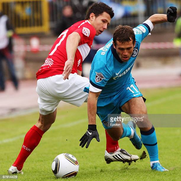 Aleksandr Kerzhakov of FC Zenit St Petersburg takes the ball past Marek Suchy of FC Spartak Moscow during the Russian Football League Championship...
