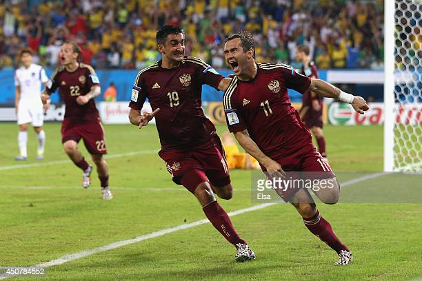 Aleksandr Kerzhakov of Russia celebrates scoring his team's first goal with Alexander Samedov during the 2014 FIFA World Cup Brazil Group H match...