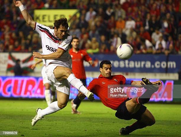 Aleksandr Kerzhakov of Sevilla has his shot on goal blocked by Savo Milosevic of Osasuna during the UEFA Cup Semi Final first leg match between...