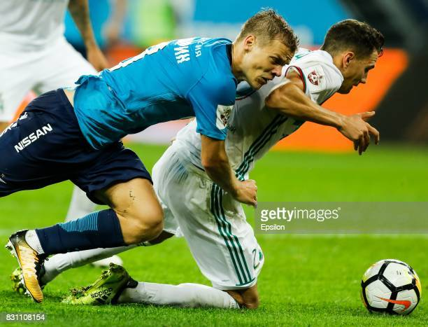 Aleksandr Kokorin of FC Zenit Saint Petersburg and Anton Shvets of FC Akhmat Grozny vie for the ball during the Russian Football League match between...