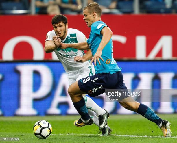 Aleksandr Kokorin of FC Zenit Saint Petersburg and Apti Akhyadov of FC Akhmat Grozny vie for the ball during the Russian Football League match...