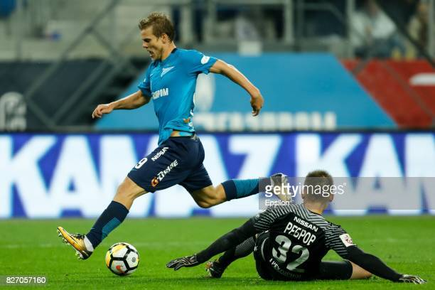 Aleksandr Kokorin of FC Zenit Saint Petersburg and Artyom Rebrov of FC Spartak Moscow vie for the ball during the Russian Football League match...