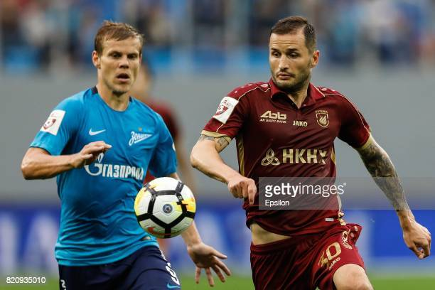 Aleksandr Kokorin of FC Zenit Saint Petersburg and Fedor Kudryashov of FC Rubin Kazan vie for the ball during the Russian Football League match...