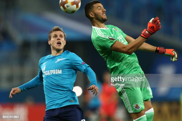 Aleksandr Kokorin of FC Zenit Saint Petersburg and Gerónimo Rulli of FC Real Sociedad vie for the ball during the UEFA Europa League Group L football...