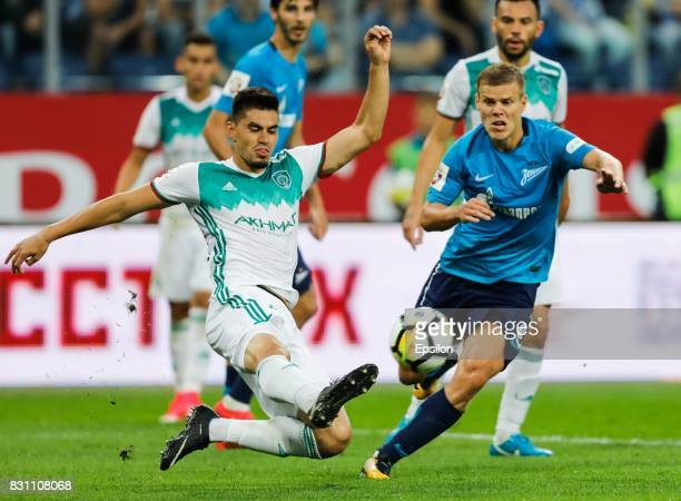 Aleksandr Kokorin of FC Zenit Saint Petersburg and Wilker Angel Romero of FC Akhmat Grozny vie for the ball during the Russian Football League match...