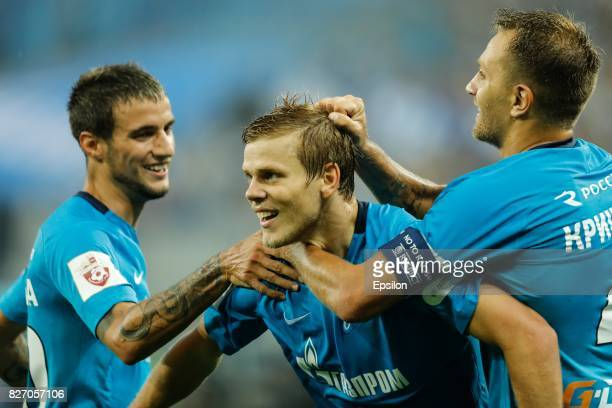 Aleksandr Kokorin of FC Zenit Saint Petersburg celebrates his goal with Emanuel Mammana of FC Zenit Saint Petersburg and Domenico Criscito of FC...