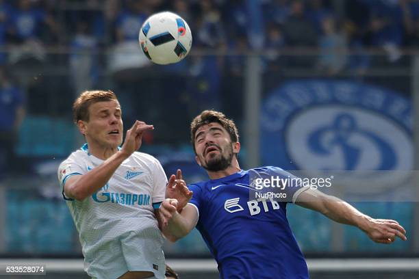 Aleksandr Kokorin of FC Zenit St Petersburg and Anton Sosnin of FC Dynamo Moscow vie for a header during the Russian Football Premier League match...