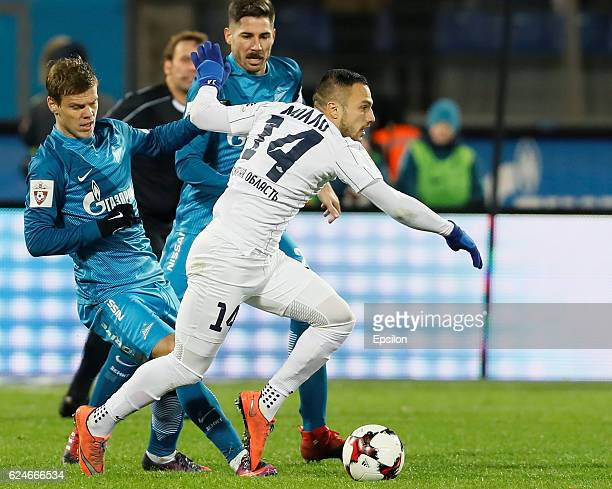 Aleksandr Kokorin of FC Zenit St Petersburg and Javi Garcia of FC Zenit St Petersburg in action against Yohan Mollo of FC Krylia Sovetov Samara...