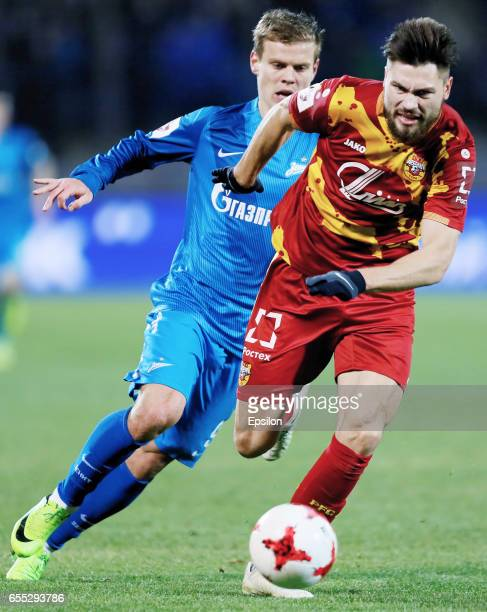 Aleksandr Kokorin of FC Zenit St Petersburg and Maksim Belyayev of FC Arsenal Tula vie for the ball during the Russian Football League match between...