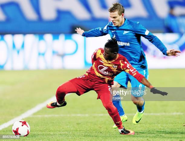Aleksandr Kokorin of FC Zenit St Petersburg and Moussa Doumbia of FC Arsenal Tula vie for the ball during the Russian Football League match between...