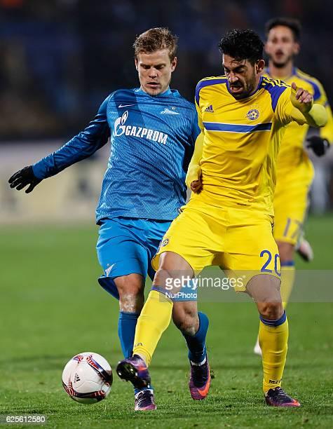 Aleksandr Kokorin of FC Zenit St Petersburg and Omri Ben Harush of Maccabi Tel Aviv vie for the ball during the UEFA Europa League Group D football...