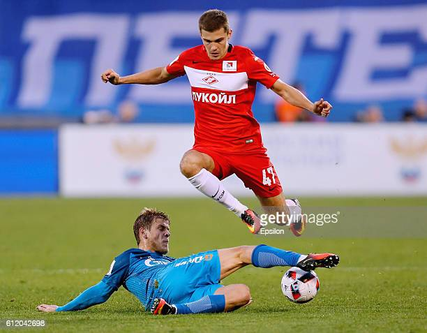 Aleksandr Kokorin of FC Zenit St Petersburg and Roman Zobnin of FC Spartak Moscow vie for the ball during the Russian Football League match between...
