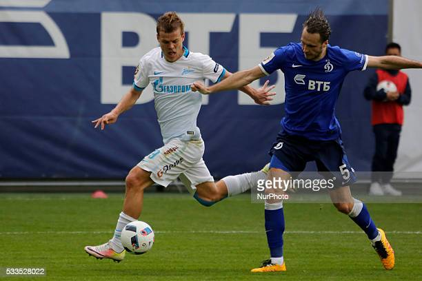 Aleksandr Kokorin of FC Zenit St Petersburg and Vitali Dyakov of FC Dynamo Moscow vie for the ball during the Russian Football Premier League match...