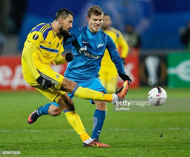 Aleksandr Kokorin of FC Zenit St Petersburg and Yegor Filipenko of Maccabi Tel Aviv in action during the UEFA Europa League Group D football match...