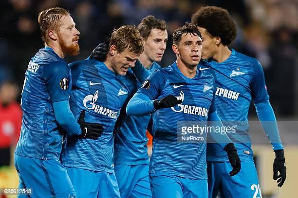 Aleksandr Kokorin of FC Zenit St Petersburg celebrates his goal with teammates during the UEFA Europa League Group D football match between FC Zenit...