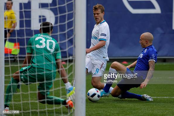 Aleksandr Kokorin of FC Zenit St Petersburg vies for the ball with Vladimir Gabulov of FC Dynamo Moscow and Sebastian Holmen of FC Dynamo Moscow...