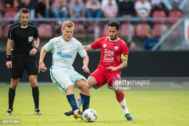 Aleksandr Kokorin of FK Zenit St Petersburg Mark van der Maarel of FC Utrecht during the UEFA Europa League fourth round qualifying first leg match...