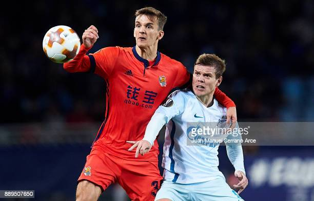 Aleksandr Kokorin of Zenit St Petersburg duels for the ball with Diego Llorente of Real Sociedad during the UEFA Europa League group L football match...