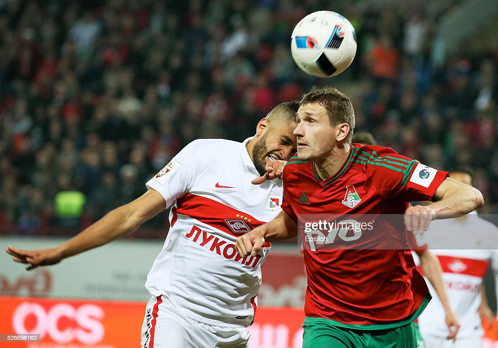 Aleksandr Kolomeytsev of FC Lokomotiv Moscow and Romulo of FC Spartak Moscow vie for the ball during the Russian Football League match between FC Lokomotiv Moscow and FC Spartak Moscow on April 30, 2016 at Lokomotiv stadium in Moscow, Russia.