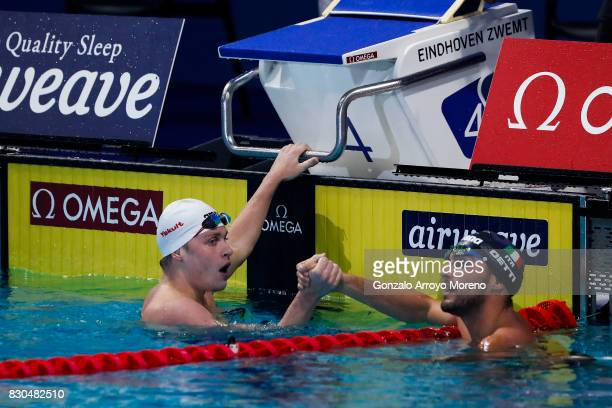 Aleksandr Krasnykh from Russia clashes hands with Gabriele Detti from Italy after winning the Men's 400m Freestyle Final of the FINA/airweave...