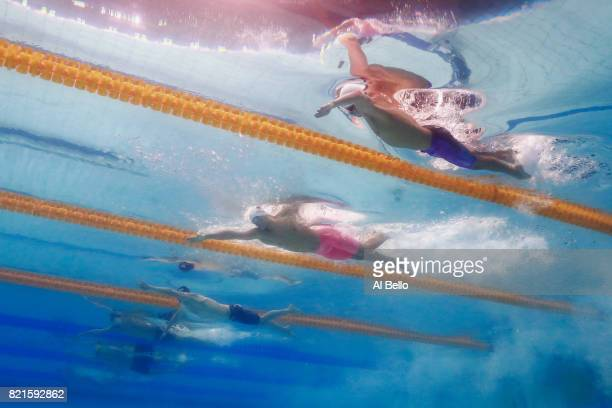 Aleksandr Krasnykh of Russia Yang Sun of China and Mikhail Dovgalyuk of Russia competes during the Men's 200m Freestyle Semifinals on day eleven of...