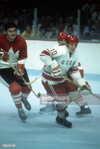 Aleksandr Maltsev of the Soviet Union skates on the ice as his teammate Boris Mikhailov tries to defend against Pete Mahovlich during Game 1 of the...