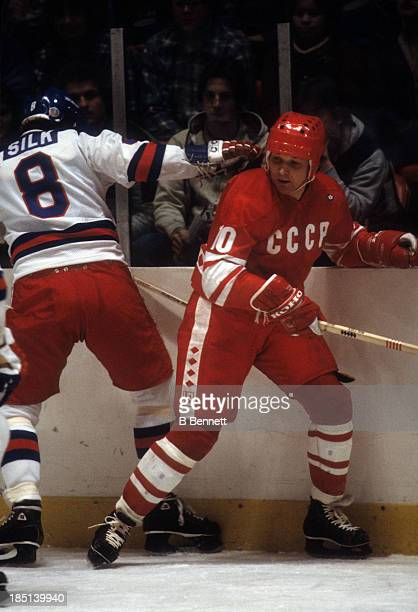 Aleksandr Maltsev of the USSR battles with Dave Silk of Team USA during an 1980 exhibition game on February 9 1980 at the Madison Square Garden in...