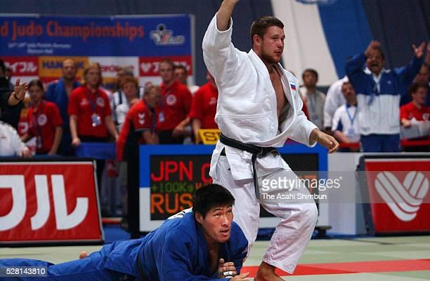 Aleksandr Mikhailine of Russia celebrates winning against Shinichi Shinohara of Japan in the Men's 100kg fourth round during the Judo World...