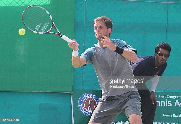 Aleksandr Nedovyesov of Kazakhstan playing against Stefano Travaglia of during the sixth day of Indore Open ATP Challenger Tennis Tournament on...