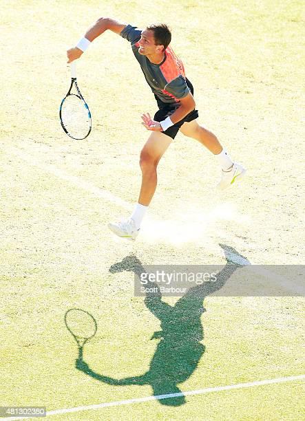 Aleksandr Nedovyesov of Kazakhstan serves during the reverse singles match between Lleyton Hewitt of Australia and Aleksandr Nedovyesov of Kazakhstan...