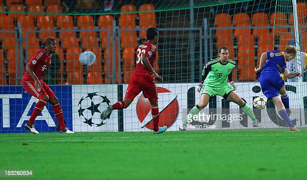 Aleksandr Pavlov of Borisov scores his team's opening goal during UEFA Champions League group F match between FC Bayern Muenchen and FC BATE Borisov...