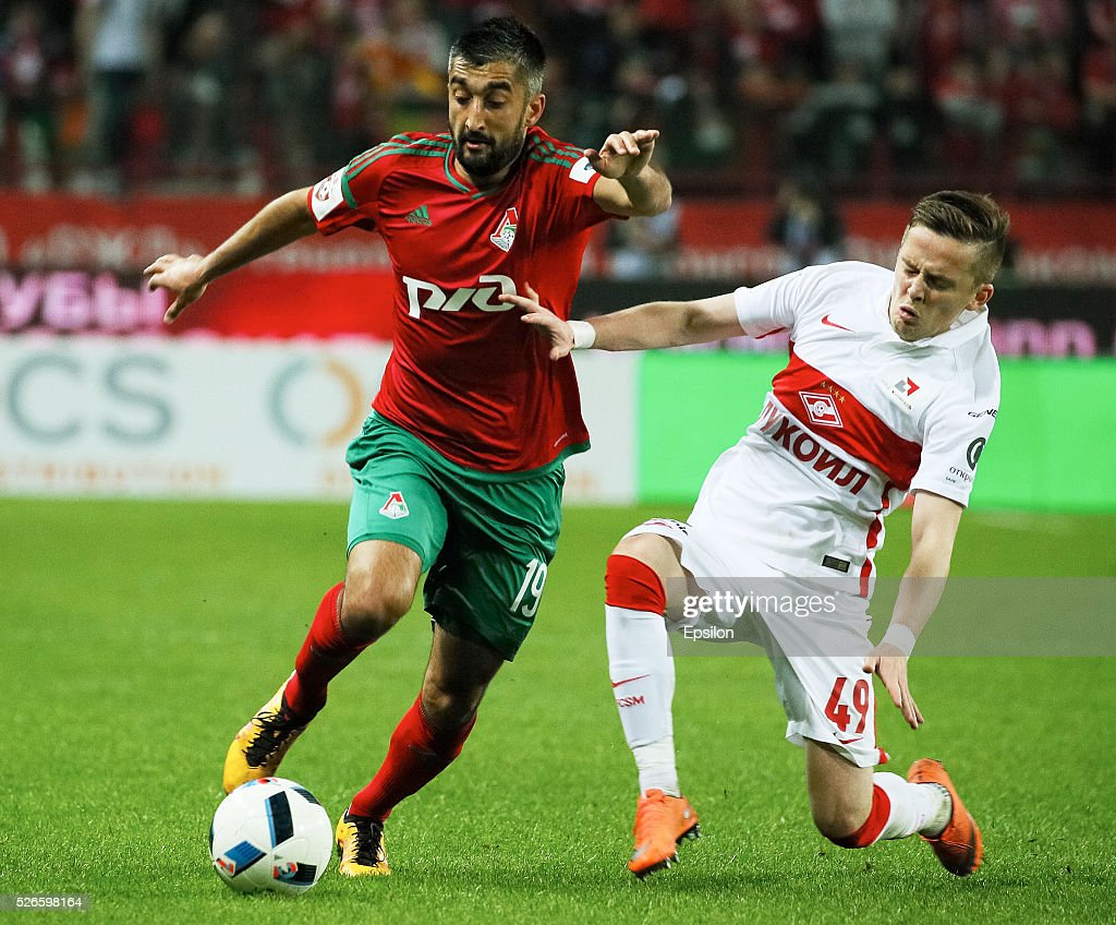 <a gi-track='captionPersonalityLinkClicked' href=/galleries/search?phrase=Aleksandr+Samedov&family=editorial&specificpeople=3995553 ng-click='$event.stopPropagation()'>Aleksandr Samedov</a> of FC Lokomotiv Moscow and <a gi-track='captionPersonalityLinkClicked' href=/galleries/search?phrase=Jano+Ananidze&family=editorial&specificpeople=6234703 ng-click='$event.stopPropagation()'>Jano Ananidze</a> of FC Spartak Moscow vie for the ball during the Russian Football League match between FC Lokomotiv Moscow and FC Spartak Moscow on April 30, 2016 at Lokomotiv stadium in Moscow, Russia.