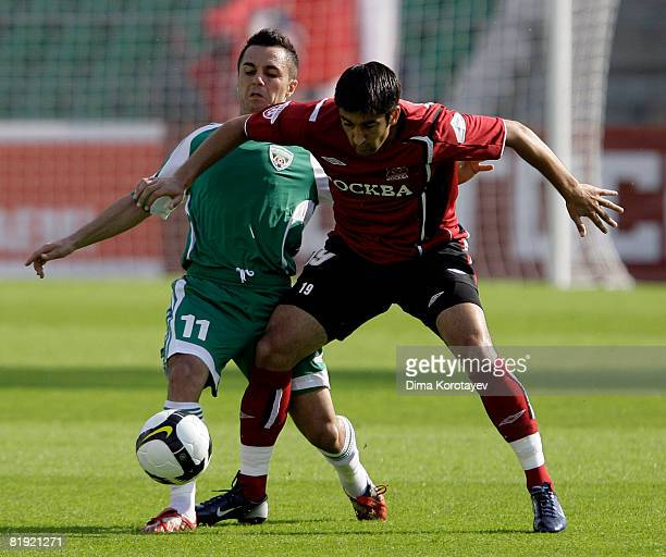 Aleksandr Samedov of FC Moscow competes for the ball with Florentin Petre of FC Terek Grozny during the Russian Football League Championship match...