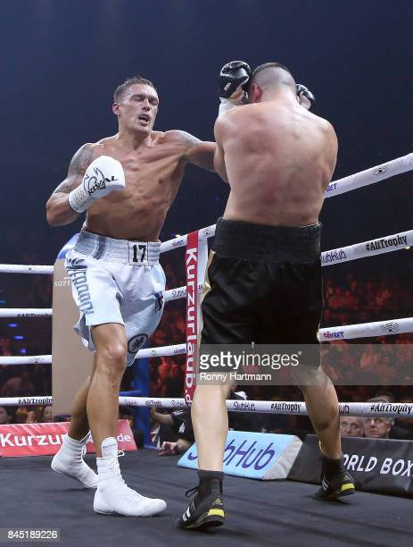Aleksandr Usyk of Ukraine and Marco Huck of Germany exchange punches during the WBO Cruiserweight World Boxing Super Series fight at Max Schmeling...