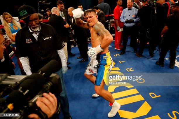 Aleksandr Usyk of Ukraine reacts after defeating Mike Hunter in their WBO Super Featherweight World Championship bout at The Theater at MGM National...