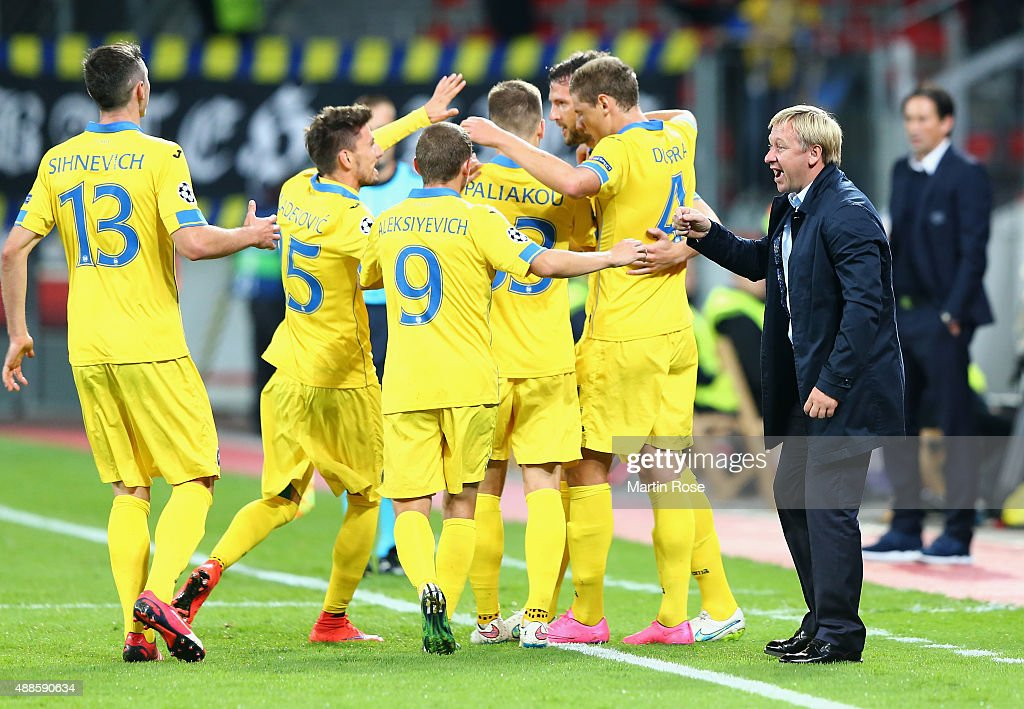 Aleksandr Yermakovich, coach of BATE celebrates with his players after his team's opening goal scored by Nemanja Milunovic during the UEFA Champions League Group E match between Bayer 04 Leverkusen and FC BATE Borisov at BayArena on September 16, 2015 in Leverkusen, Germany.