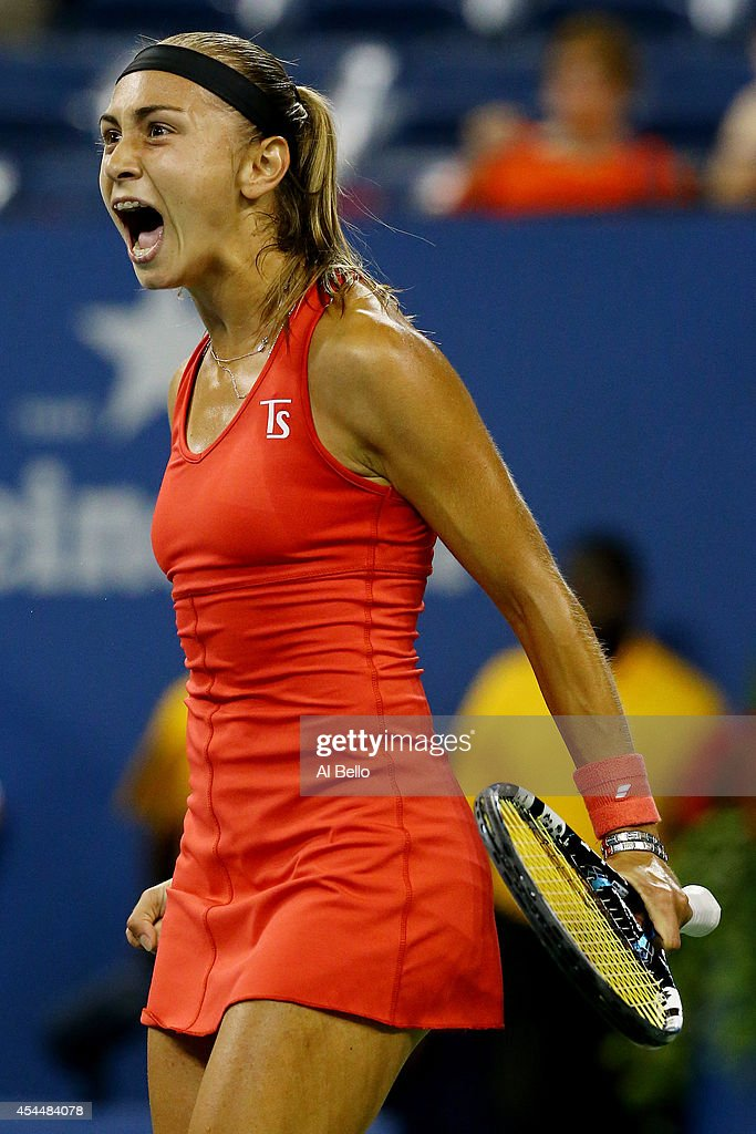 Aleksandra Krunic of Serbia reacts after winning the first set against Victoria Azarenka of Belarus during their women's singles fourth round match on Day Eight of the 2014 US Open at the USTA Billie Jean King National Tennis Center on September 1, 2014 in the Flushing neighborhood of the Queens borough of New York City.