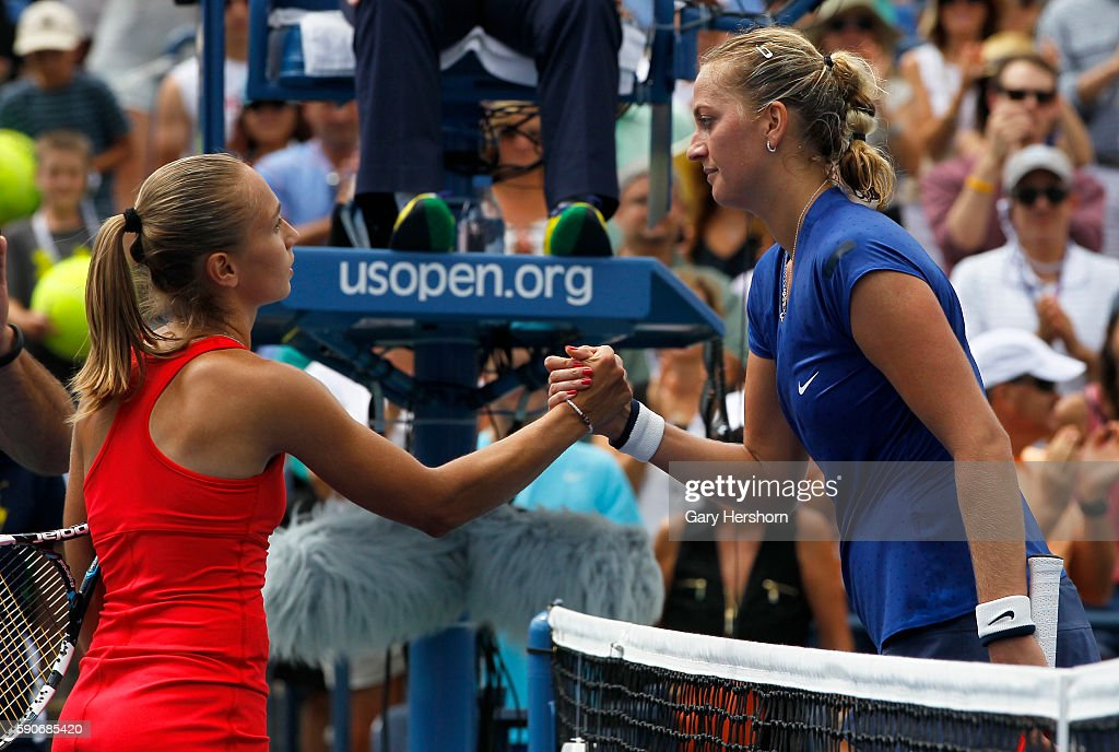 Aleksandra Krunic of Serbia shakes hands with third seed Petra Kvitova of the Czech Republic after her upset victory at the US Open in New York...