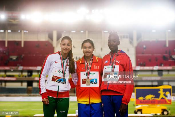 Aleksandra Nacheva of Bulgaria Quijiao Tan of China and Zulia Hernandez of Cuba pose in the girls triple jump medal ceremony during day 4 of the IAAF...