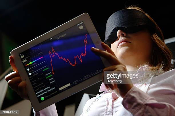 Aleksandra Siciarz chief marketing officer at Inteliclinic Inc demonstrates the Neuroon an eye mask that can analyze your sleep pattern at the...