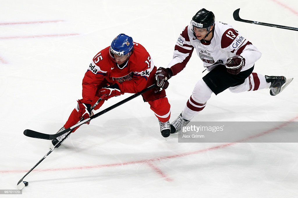 Aleksandrs Jerofejevs (L) of Czech Republic is challenged by Guntis Galvins of Latvia during the IIHF World Championship group F qualification round match between Czech Republic and Latvia at SAP Arena on May 17, 2010 in Mannheim, Germany.