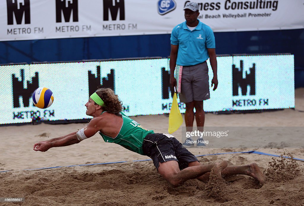 Aleksandrs Samoilovs of Latvia dives for the ball during the Men's final between Aleksandrs Samoilovs and Janis Smedins of Latvia and Martins Plavins and Aleksandrs Solovejs of Latvia at the FIVB Durban Open at New Beach on December 14, 2013 in Durban, South Africa.