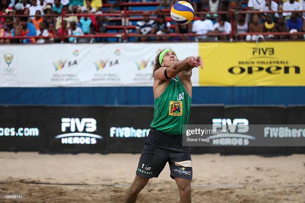 Aleksandrs Samoilovs of Latvia sets the ball during the Men's final between Aleksandrs Samoilovs and Janis Smedins of Latvia and Martins Plavins and Aleksandrs Solovejs of Latvia at the FIVB Durban Open at New Beach on December 14, 2013 in Durban, South Africa.