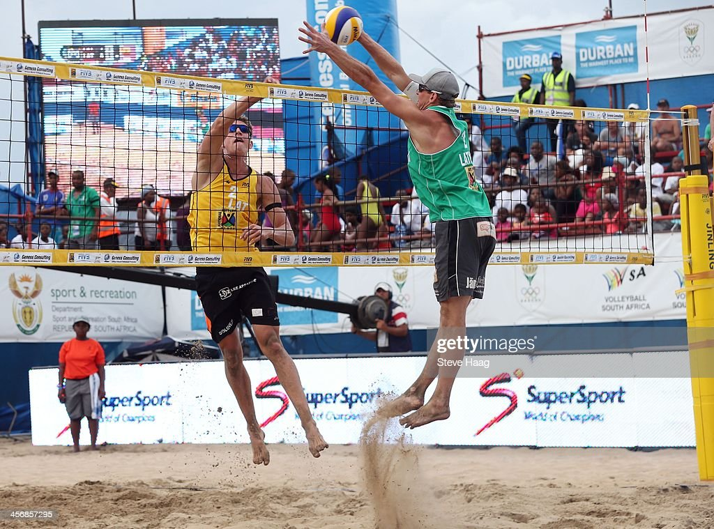 Aleksandrs Solovejs of Latvia (R) Janis Smedins of Latvia during the Men's final between Aleksandrs Samoilovs and Janis Smedins of Latvia and Martins Plavins and Aleksandrs Solovejs of Latvia at the FIVB Durban Open at New Beach on December 14, 2013 in Durban, South Africa.