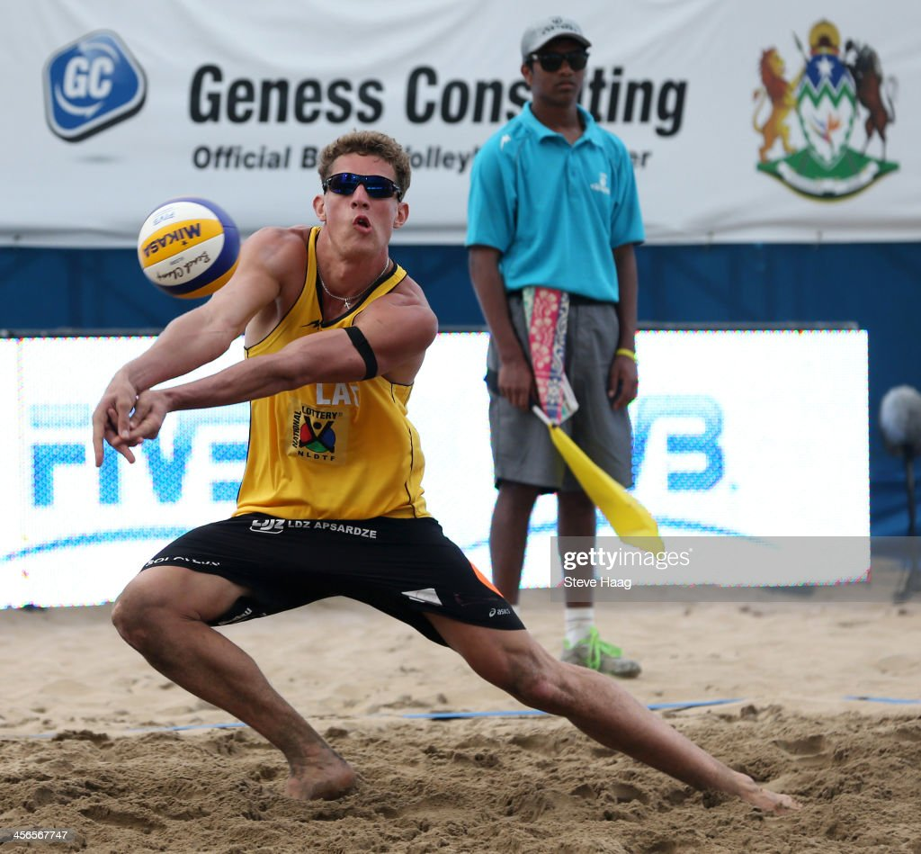 Aleksandrs Solovejs of Latvia sets the ball during the Men's final between Aleksandrs Samoilovs and Janis Smedins of Latvia and Martins Plavins and Aleksandrs Solovejs of Latvia at the FIVB Durban Open at New Beach on December 14, 2013 in Durban, South Africa.